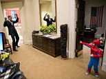 Gotcha: President Barack Obama pretends to be caught in Spider-Man's web as he greets the son of a White House staffer in the Outer Oval Office in October