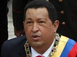 Ill: Venezuelan president Hugo Chavez is in an induced coma being kept alive by life support following complications during cancer surgery, it was claimed today. He is pictured earlier this year