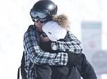Bear hug: Locked in a tight embrace on the slopes of the Verbier ski resort yesterday, Prince Harry and his society girlfriend Cressida Bonas seem to be closer than ever