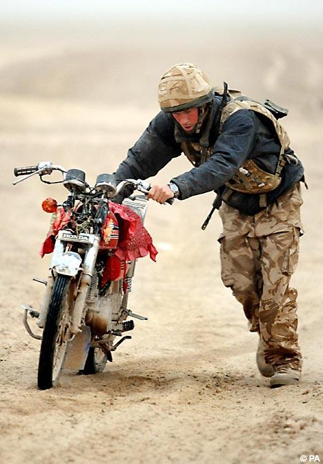 Harry pushing bike
