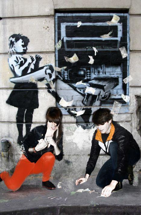 Banksy graffiti of a girl being taken by a cashpoint machine, Rosebery Avenue London EC1