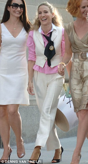 Well suited: Carrie ties up the tailored look