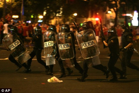 Disruption: Riot police charge Spanish fans in Madrid