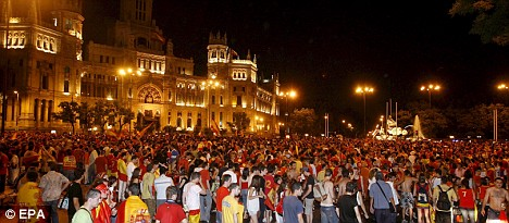Sea of support: Thousands of Spanish fans celebrate at Cibeles square in Madrid
