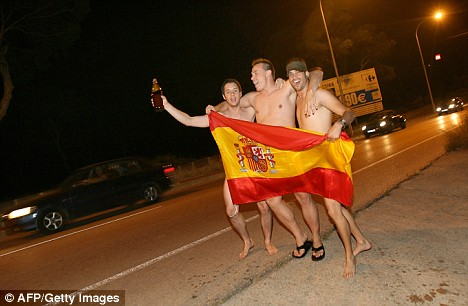 Fans' joy: Naked Spanish supporters celebrate after beating Germany