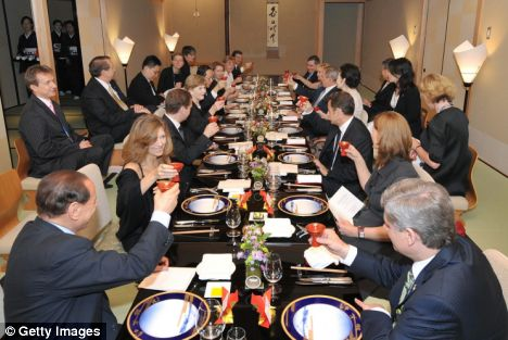 G8 leaders discussing the world food crisis in Japan raise their glasses ahead of an 18-course dinner