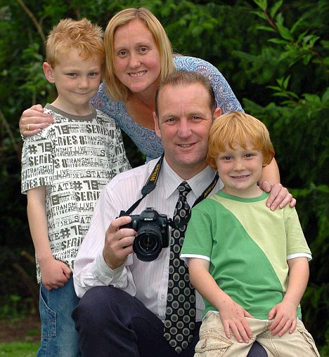Gary and Tracey Crutchley with Cory, left, and Miles