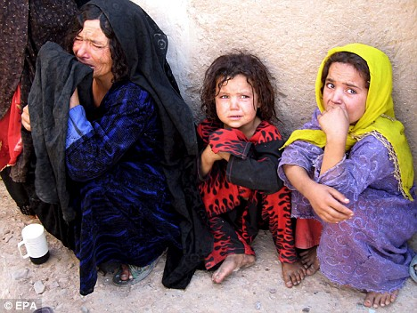 An Afghan woman mourns the death of a relative following a US-led coalition airstrike in western Herat province