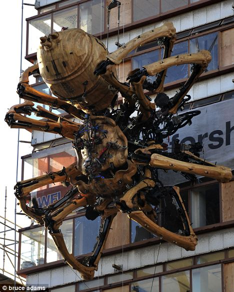 Looming: The giant 37-ton spider clings on the side of Liverpool's concourse building