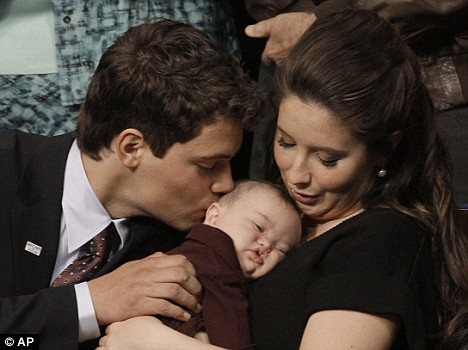 Levi Johnston kisses Trig, Down's syndrome brother of his pregnant fiancee Bristol Palin, right