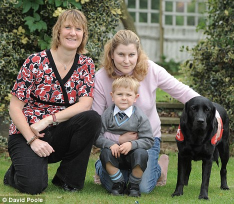 Noah and his dog Bianca(lab/retriever cross) and mum and Charity lady Claire