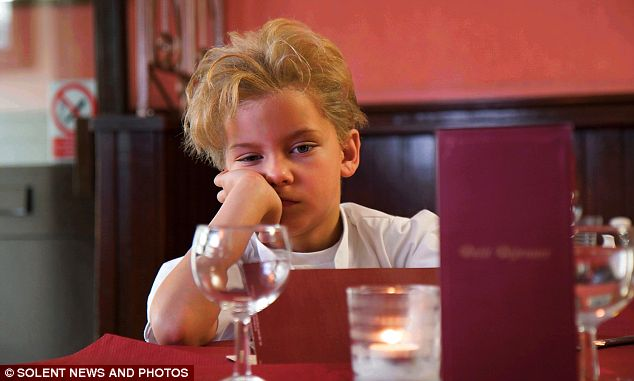 Unimpressed: Little Gordon walks out of a restaurant after waiting an hour for his starter