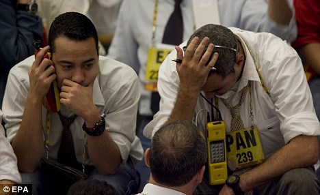 Downturn: Wall Street traders found themselves looking at ruin as the Dow Jones Index went from bad to worse - the worst day of trading in history
