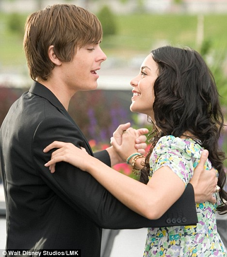 Puppy love: Vanessa Anne Hudgens and Zac Efron dance in a scene from  High School Musical 3 - the pair do not so much as French kiss in the film