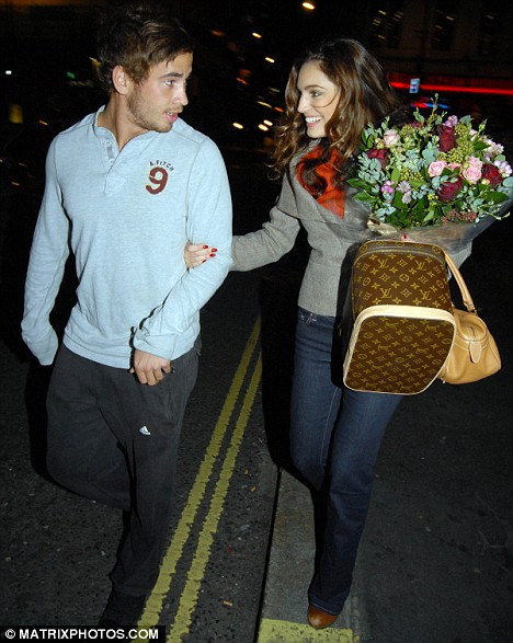 Supporting role: Kelly's new boyfriend Danny Cipriani celebrate after her debut