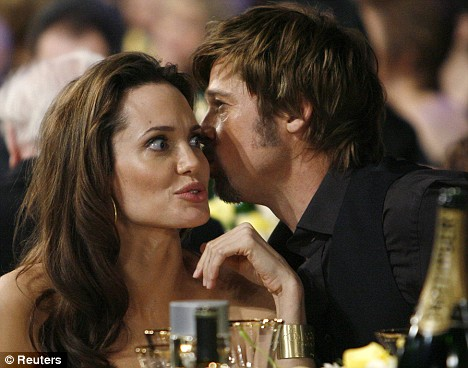 Actors Jolie and Pitt share a private thought at an awards ceremony