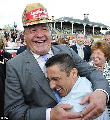 Previous form: Sir Michael Stoute hugs jockey Frankie Dettori after they won the St Leger Race with Conduit at Doncaster