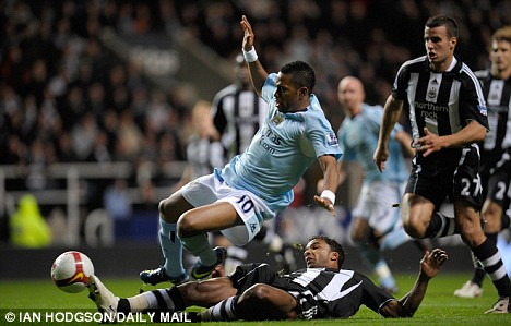 Flashpoint: Beye brings down Robinho for a penalty awarded by Rob Styles (below)