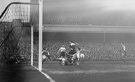 John Brooks, the Tottenham inside left beats Jack Kelsey, the Arsenal goalkeeper and Jim Fotheringham, the Arsenal centre half, to score his side's