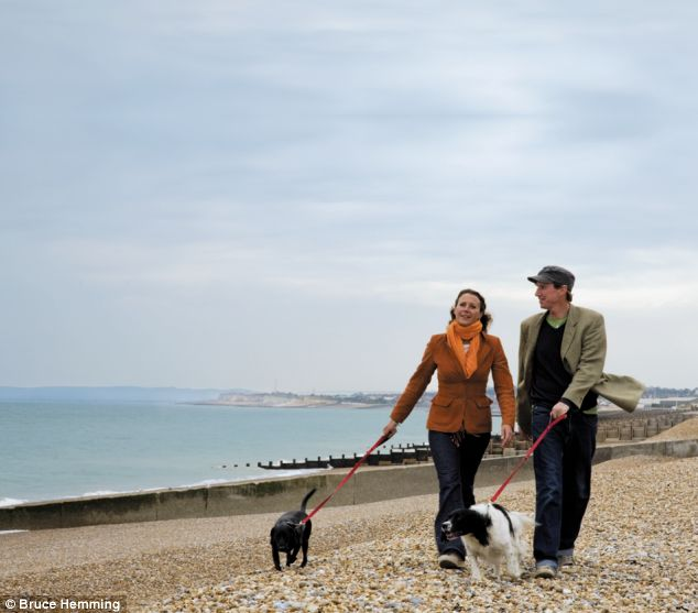 Anna and her partner Blair walk their dogs Jessie and Poppy along the beach in Hastings.