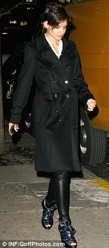 Chic: Katie Holmes leaves her apartment in New York sporting a pair of kinky stilettos and leather tights