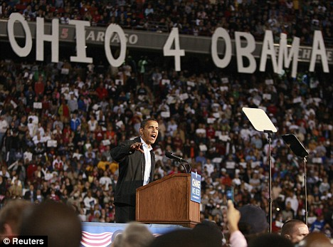 Battleground: Barack Obama, leading in the polls, thunders at an audience in the key battleground state of Ohio yesterday