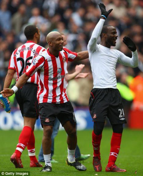 El-Hadji Diouf (left) and Pascal Chimbonda of Sunderland celebrate victory over Newcastle