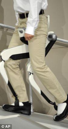 A researcher shows off Honda Motor Co., Ltd.'s experimental walking assist device