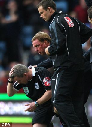Assistant referee hit by a coin at Aston Villa
