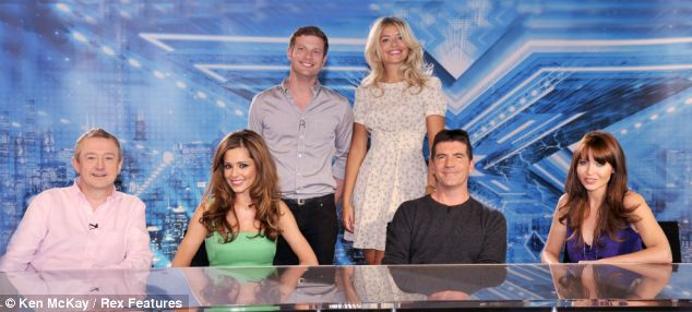 The X Factor team, from left: Louis Walsh, Cheryl Cole, Dermot O'Leary, Holly, Simon Cowell, Dannii Minogue