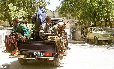 War-torn: Government troops patrolling the streets of the capital, Mogadishu