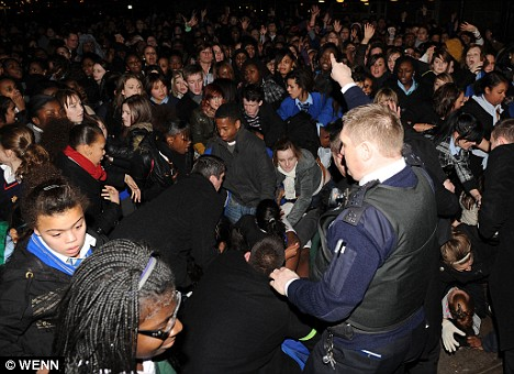 JLS mania: Police struggled to hold back thousands of teenagers during a stampede at a gig in Croydon last week