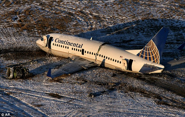 Snapped in two: The wreckage of the Continental flight