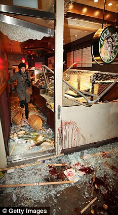 The damage caused to a Starbucks cafe in Kensington. Blood can be seen on the outside of the building, windows were smashed, and the inside was extensively damaged