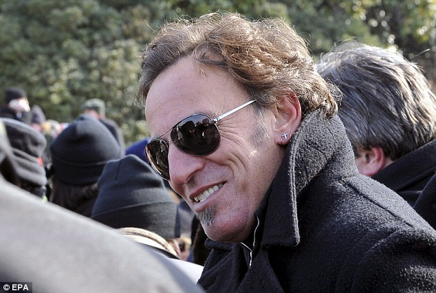 Singer Bruce Springsteen watches the inauguration