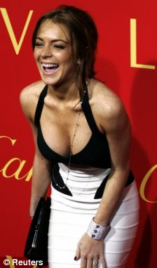Healthier: Lohan in 2004 at the MTV Movie Awards, and then in 2006, after an earlier 'skinny' phase