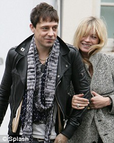 Kate Moss and boyfriend Jamie Hince are pictured leaving their local pub following a romantic lunch