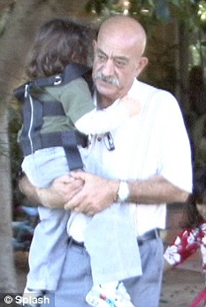 Grandfather-of-14: The octuplet's grandfather Edward Suleman with one of his daughter's six elder children