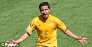 Tim Cahill of Australia celebrates after scoring their second goal against Japan during their Group F World Cup 2006 soccer match in Kaiserslautern June 12, 2006. Aus