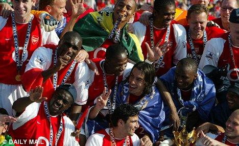 Arsenal's stars celebrate winning the title in 2004