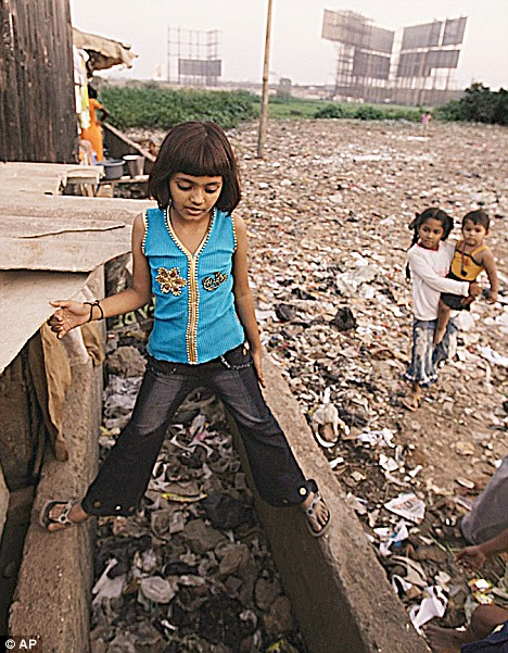 Disease: Rubina stands over a blocked drain near her house