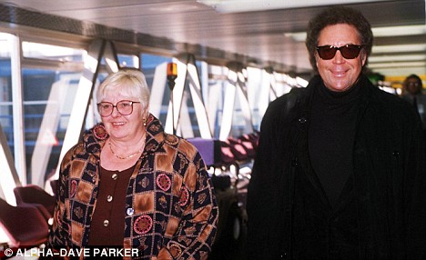 Still brown: Tom Jones and Linda pictured in 2002
