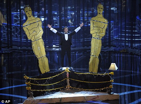 Host with the most: Actor Hugh Jackman did a dazzling turn as the unusual pick for the job of Oscar host