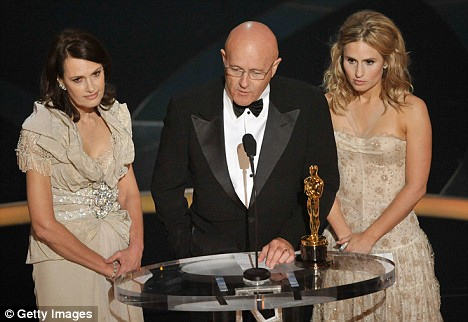 In a moving moment the late Heath Ledger's father Kim accepted his son's Oscar flanked by Heath's mother Sally Bell and sister Kate