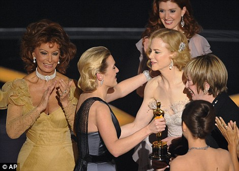 Kate, centre, is congratulated by Sophia Loren, left, Nicole Kidman, Shirley MacLaine and last year's winner Marion Cotillard