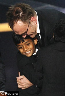 Triumphant: Director Boyle celebrates with Azharuddin Mohammed Ismail (youngest Salim)