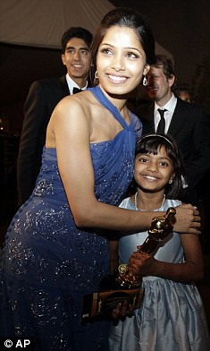 Freida Pinto with co-star Rubiana Ali whose mother watched her on television in the slums of Mumbai