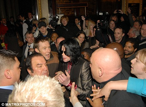 Mobbed; Michael Jackson had to battle his way through waiting crowds at his London hotel to take his children to watch the musical Oliver! at The Theatre Royal, Drury Lane