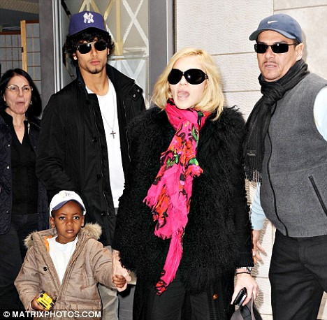 Getting close: Jesus Luz has reportedly moved into Madonna's New York apartment, where she even cooks for him