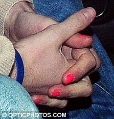 In the pink: Harry's nails were painted with varnish
